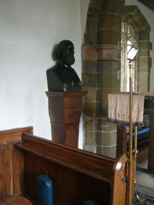Close up of the front pew and the bust of Tennyson.