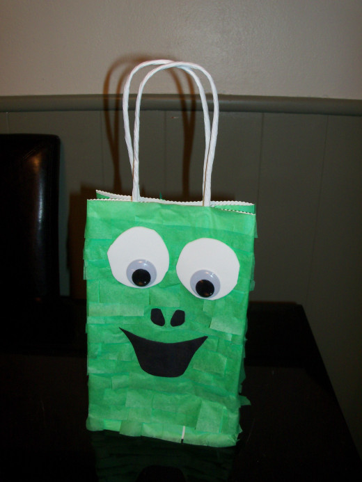 This is a fun dragon design that younger boys will like- the front of the bag. P.S. Kids LOVE googley eyes!