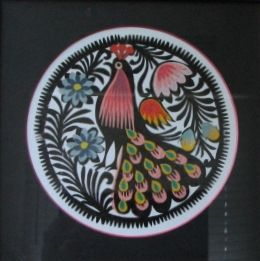 Wycinanki is the Polish word for paper-cut designs. They have been used to decorate the interior of Polish homes since the early 19th century.  They re easy to find in gift shops and ethnographic museums.  The more complex they are, the more expensiv