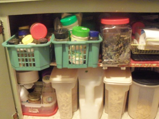 I have 2 baskets of spices and some dried herbs in a plastic jar in the cupboard under the stove