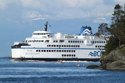 I love the contrast between the mammoth BC Ferries ship, the outboard safety boat, and the OC6 in the foreground, just rounding the northern end of Newcastle Island. (2011 NCKC Crazy 8s, Nanaimo, BC.)