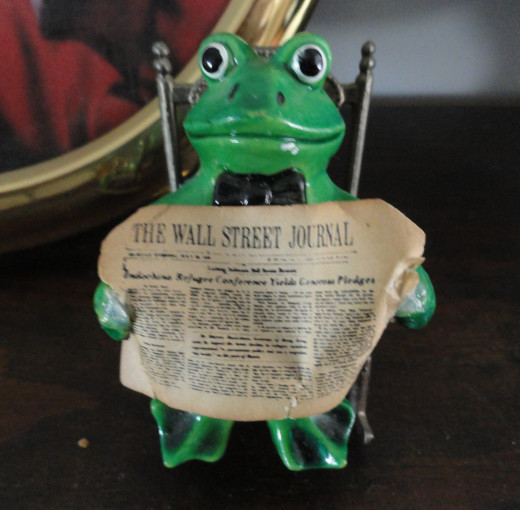 Rocking Frog can read again. Newspaper glue back on on.