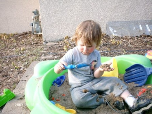My son in his sandbox.