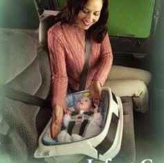 Baby buckled up in car bed. Photo by the newparentsguide.com
