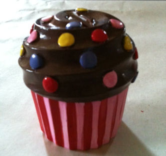 The painted cupcake with a second coat, and red strips on the wrapper.