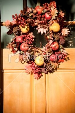 Add the colors of autumn to your pine cone wreath