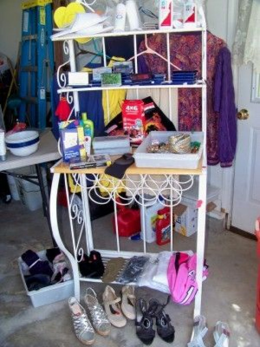 Use tables and displays such as this bakers rack I used for jewelry, beauty items and smaller items