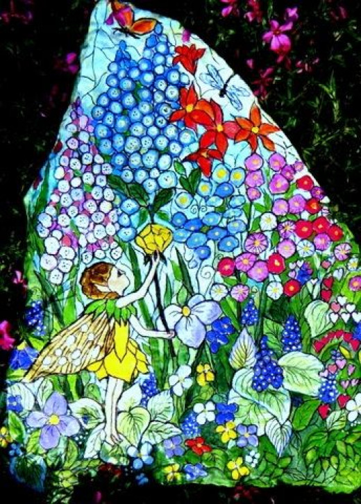 Hand painting flowers fairies on garden rocks hubpages - Painting rocks for garden what kind of paint ...