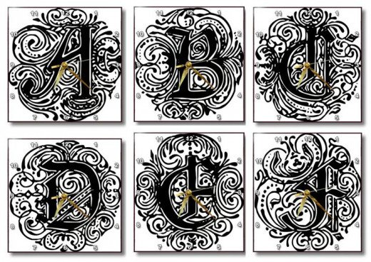 Fancy Letter A to Z Monarchia Wall Clocks on Amazon