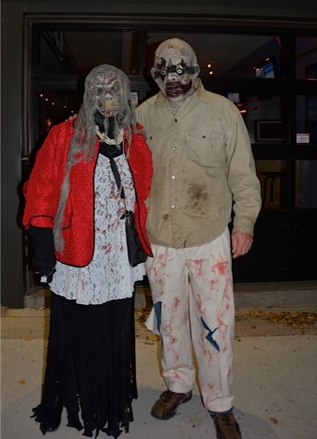 This creepy couple opted for masks, which will serve them well in future zombie walks.  I think it's a great option as well.