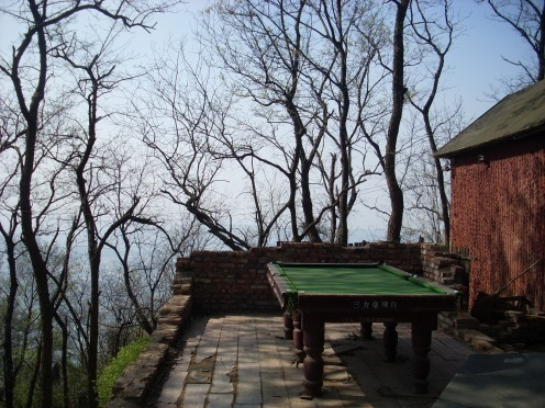 Okay, now what could honestly be strange about having a pool table out in the open on top of a mountain.