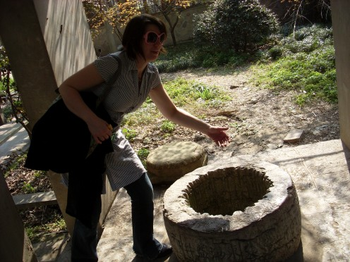 My daughter checking to see if I'd be able to pee into a well from the Ming Dynasty.