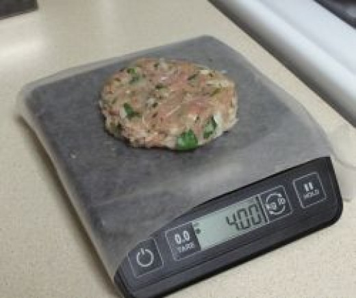 Weighing the turkey burger patty