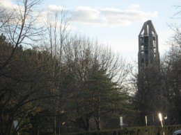 Moser Tower seen from a distance through Naperville's Riverwalk Park