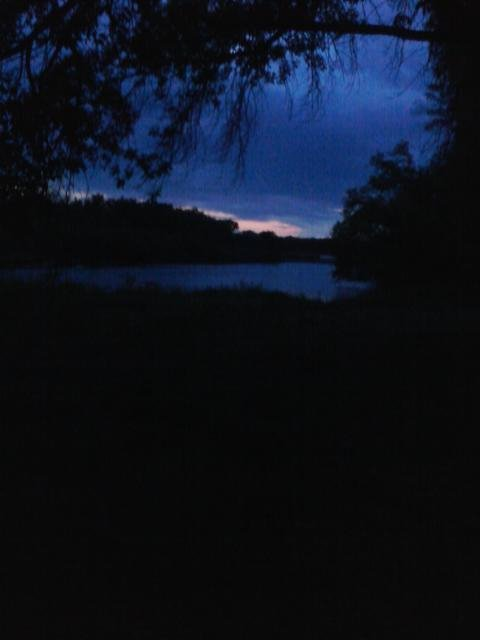 This is a shot I took with my phone in Granite Falls, MN.  It's a sunset over the Minnesota River.