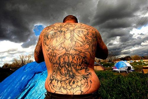 Tattooed tent city resident