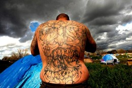 Tattooed tent city resident