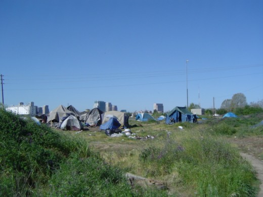 Tent city with Sacramento sky line in the background