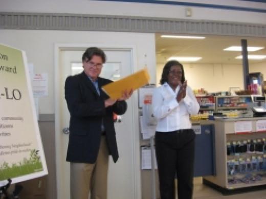 PPIM presents Julia Frazier of Bi-Lo with the Community Spirit Award