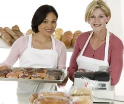 Women Holding Platters of Donuts