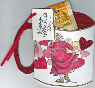 Cup shaped Valentine card with dancing woman. The card contains a teabag.