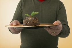 Man holding a serving of fruit cake on a platter