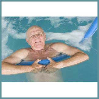 Senior Man Exercising in Swimming Pool