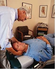 Chiropractor Working on a Patient
