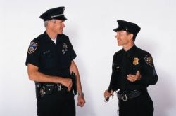 Two Police Officers in Uniform