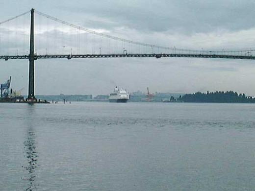 Cruise ship Passing Under Lions Gate Bridge