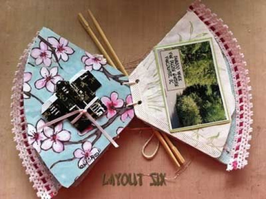 Page layout, open. Left side has origami kimono made from Asian paper and trimmed with pink ribbon. Left side has stamped image of bamboo, with photograph of Bamboo Walk taken in Vancouver's Van Dusen Gardens.