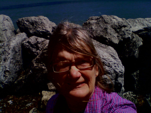 A pause in a bike ride by the rocks at Lake Michigan in Evanston yesterday.