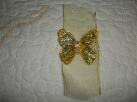 Here is the butterfly with the tail on both ends decorated with the glitter glue. Fold over the tails and secure with floral wire to create a tail.