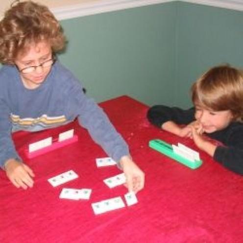 My sons playing Rummikub