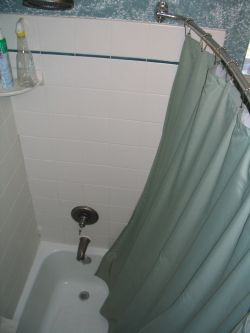 The shower curtain bows away from your body, giving you more room