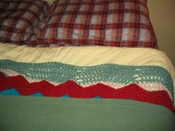 The secret to a good night is lot and lots of layers of blankets! (My bed has flannel sheets and four blankets.)