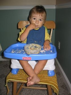 My younger son some years ago in his high chair. Photo by Valerie Bloom