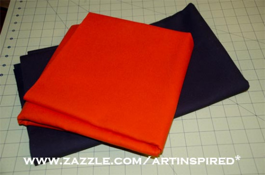 This is orange and black canvas duck cloth used to make the pennants for the banner.