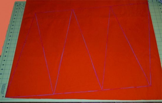 Here is the orange duck cloth with my traced triangle pennants outlined in tailors chalk.