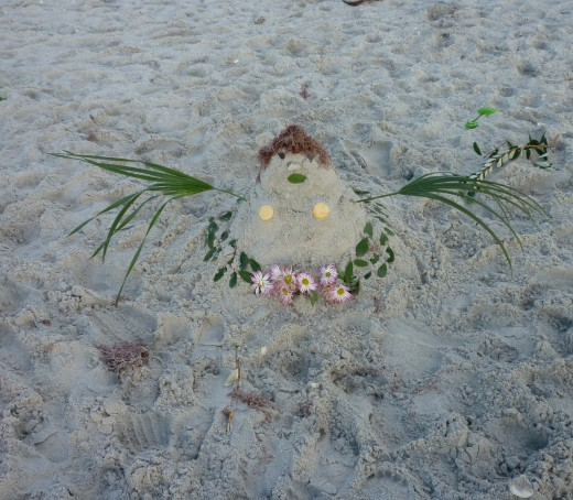 Shells even find their way onto a sandy hula dancer's costume!