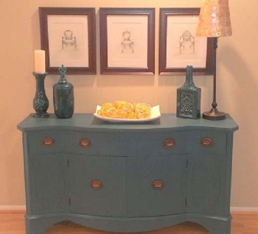 Bowfront Console (Originally it was banana yellow: I painted it dark teal): $80