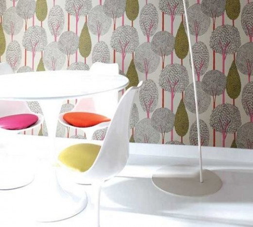 This Harlequin vignette features more of their fabric and wallcoverings used in a much more spare manner, while still retaining a bold and bright presentation.