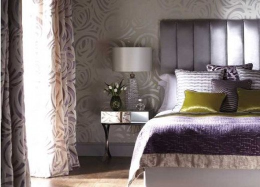 What a beautiful room can be made using primarily lilac, green and gray from this up-and-coming Art Deco-inspired trend.  The use of the channel-back upholstered headboard and polished chrome base of the side table echos the straight and curved lines