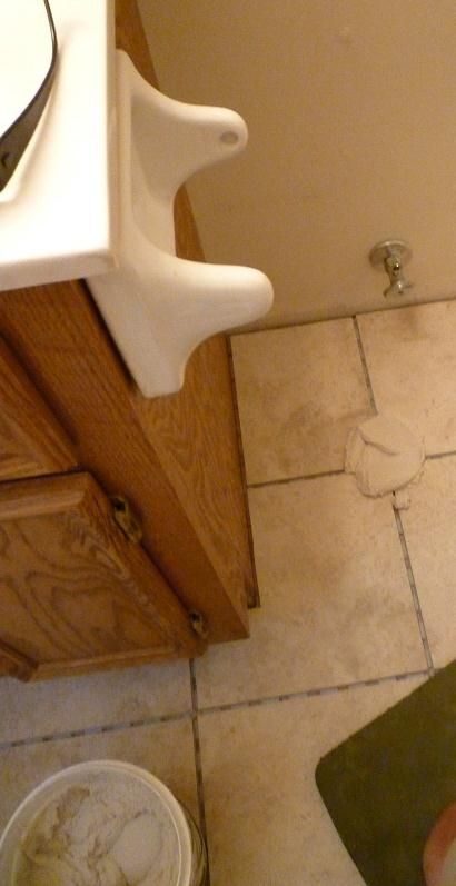 Plop down a glob of grout on a tile joint.  Position your grout float at a 45-degree angle and start to force the grout into the joint.  Clean off the excess grout by placing your float at a 90-degree angel and dragging it diagonally across the grout