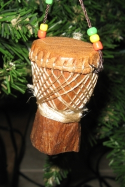 A miniature African drum hanging on my neighbor's Christmas tree.