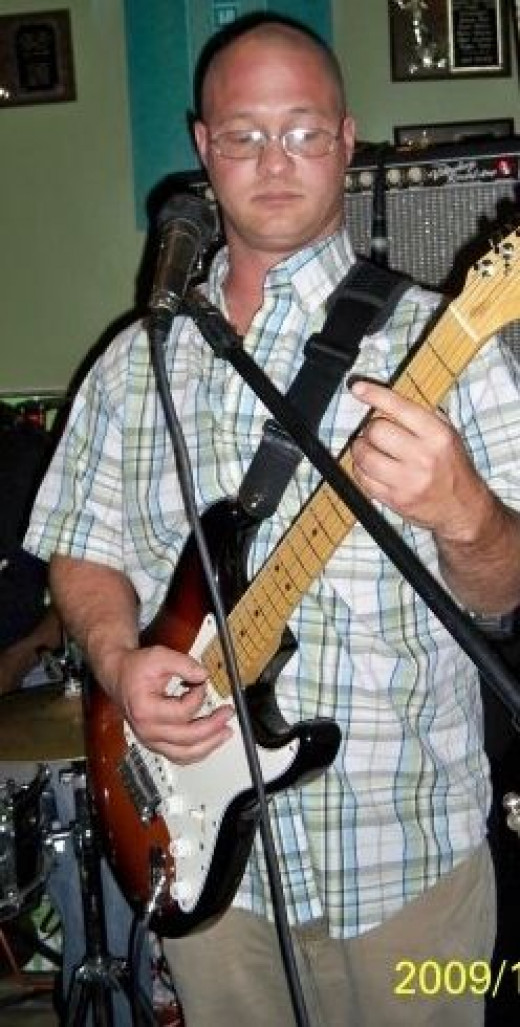 Danny playing guitar