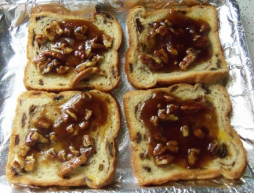 Spoon pecan and sugar mix in the middle of toasted bread.