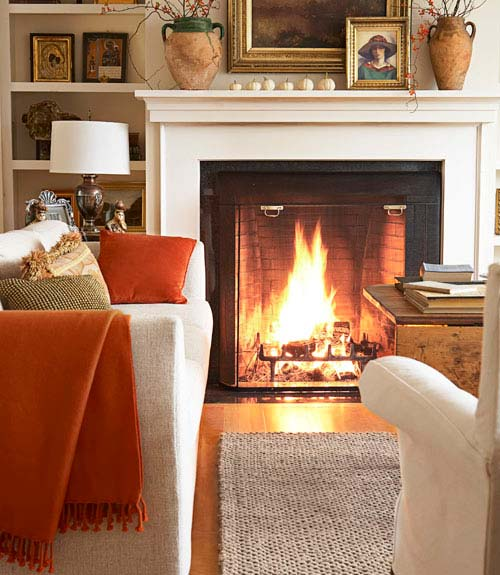 Orange throws on cream colored furniture give a good balance and are a nice touch.