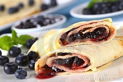 Pancakes filled with blueberry jam.