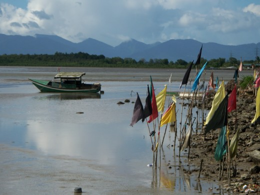 Mudflats and prayer flags